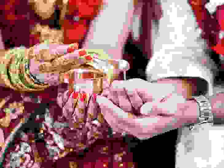 Bride and groom hands from Indian wedding celebration