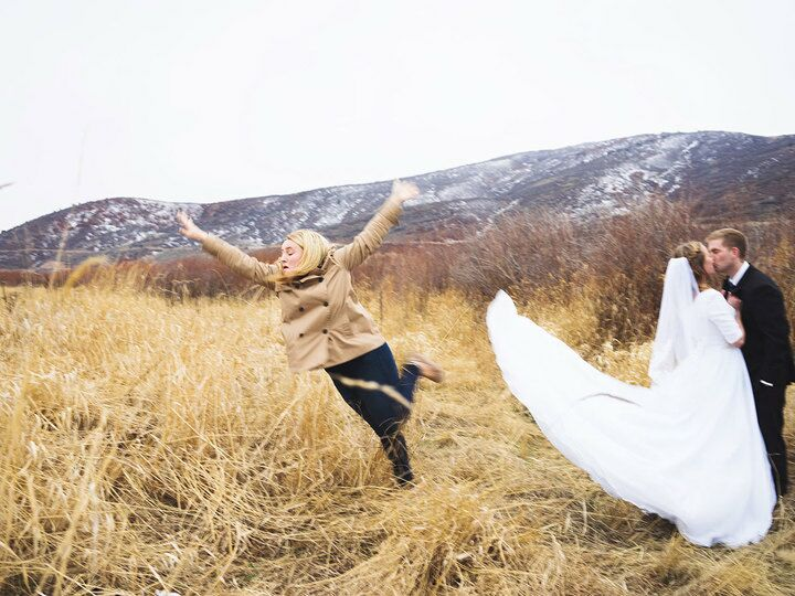 bridesmaid jumps out of wedding photo