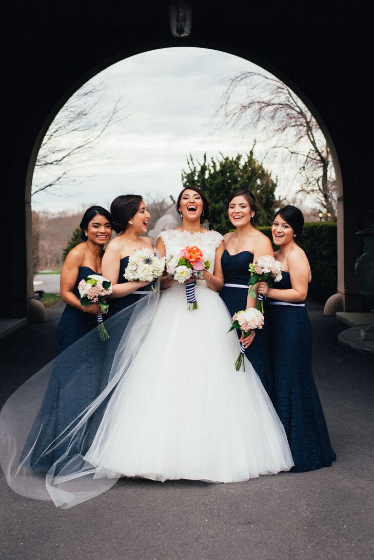 With the wedding decor centered on a nautical theme, a blue, white and gold palette was a given. The couple incorporated the classic hues into every detail, right down to their wedding party's attire. For her bridesmaids, Yecelin had them don matching navy chiffon Wtoo gowns in a strapless A-line silhouette.