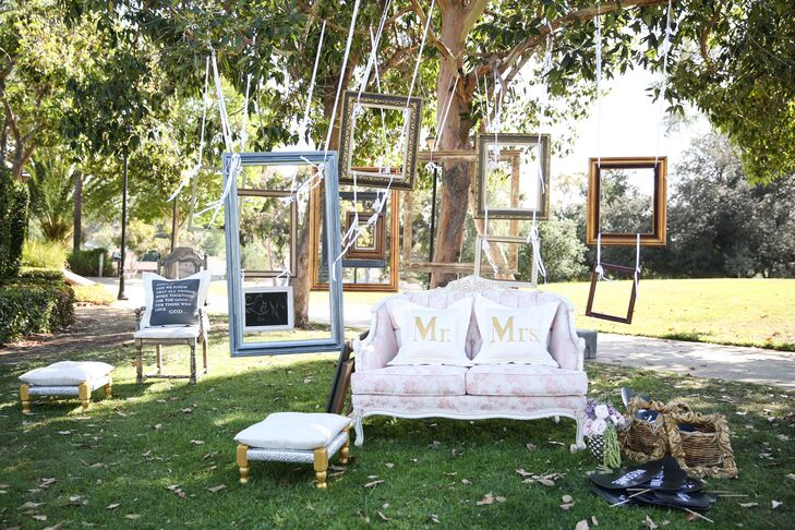 """""""We had a sitting area with a couch and picture frames, and that was a big hit,"""" Lidia says. """"I loved that my guests could relax and just hang out and talk to one another."""" Lidia and Nick had white and gold """"Mr."""" and """"Mrs."""" throw pillows on the couch for a little glamorous flair."""