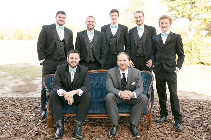Of course, Austin and his groomsmen also wanted to add a little country to their looks. They all stepped out for a few photos in formal black tuxedos from Men's Wearhouse and black cowboy boots. The groomsmen also matched the wedding palette with bright turquoise bow ties.