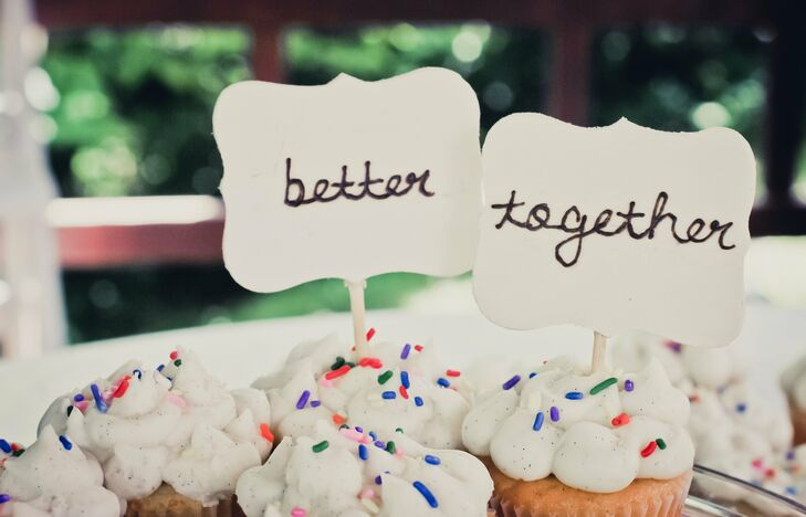The assortment of cupcakes were made special with cute accents like these better together cupcake toppers.