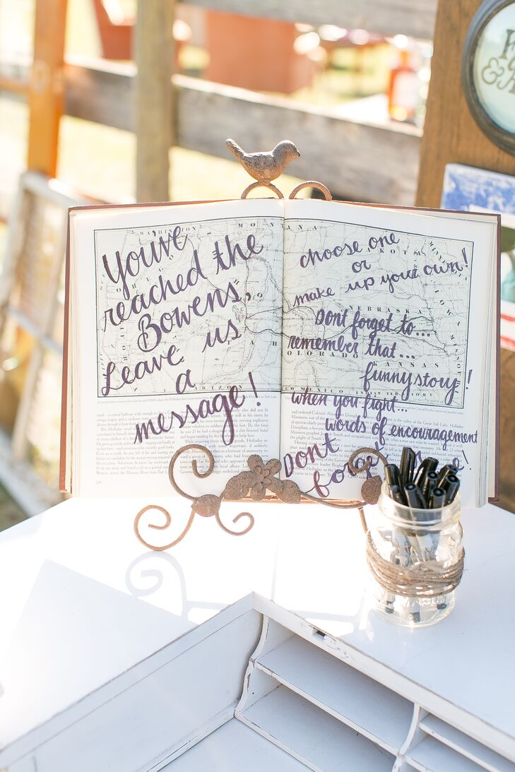 For their guest book, Katie and Austin asked every guest to leave them a message on this white vintage desk, which also had a vintage telephone. Their message paper was just as clever with stag illustrations that fit their country theme.