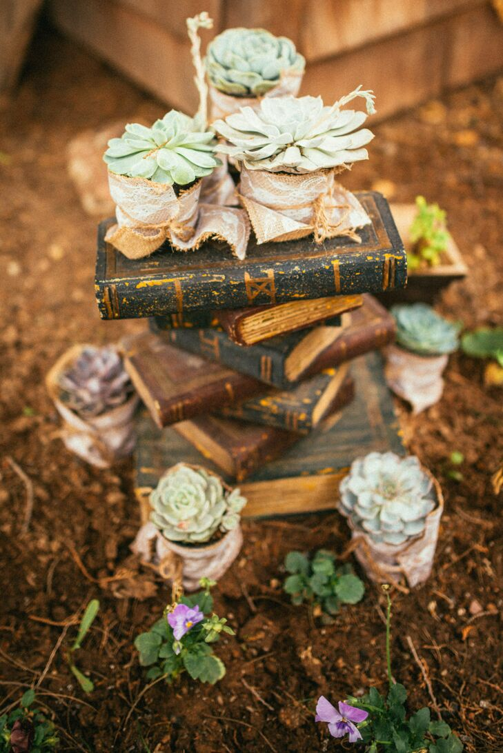 Whimsical details covered the grounds, from old books sprinkled with gold and topped with succulents wrapped lightly in burlap and lace.