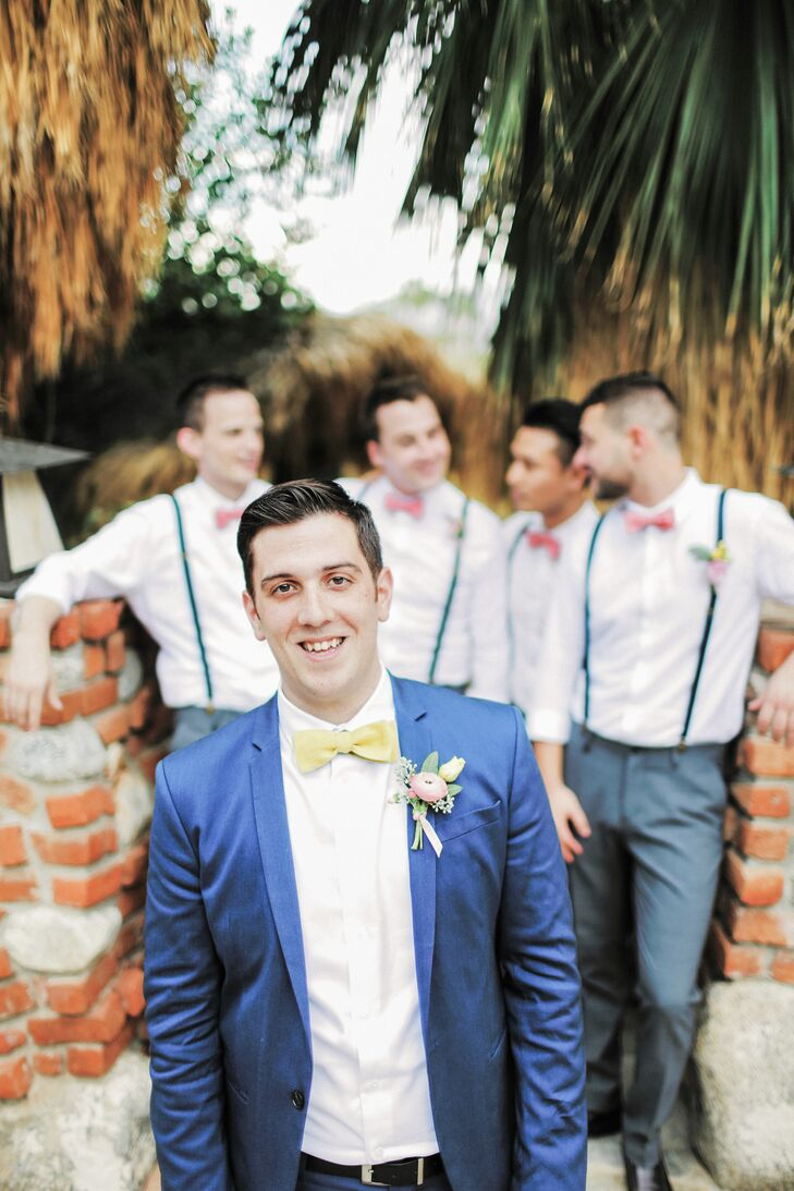 Brian wore a navy suit from Zara while his groomsmen wore grey slacks with suspenders. Bowties in pink and yellow matched the event's bright color palette.