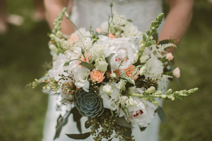 Hayley's wildflower bouquet held a mix of mint, white and coral flowers.