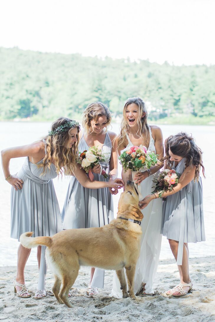 Chrissy's bridesmaids, her sister and two best friends, donned convertible knee-length dresses in soft, pale shades of gray and strappy white sandals that fit perfectly with the wedding's laid-back vibe.