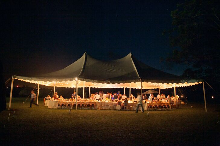 A large, peaked tent sat atop a long table where guests dined during the reception.