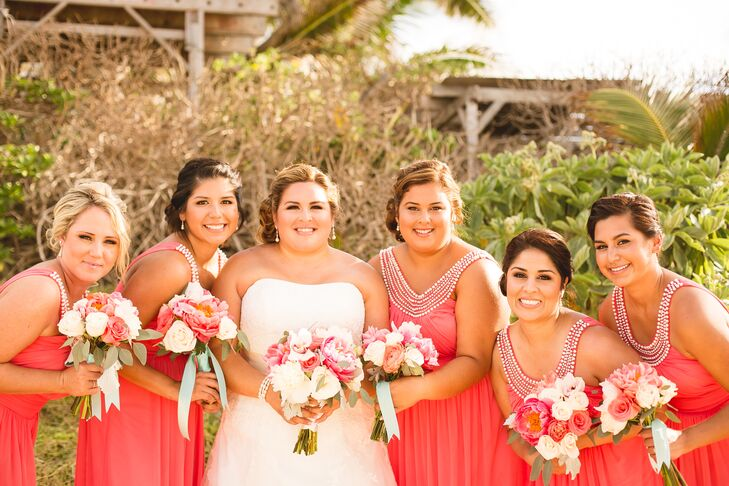 """""""I let the bridesmaids choose their own dresses, just as long as they were all the same color of coral,"""" Veronica says. """"I wanted the girls to be comfortable and cool, since I knew it was going to be warm."""" The floor-length coral dresses incorporated a scoop neckline embellished in beads, giving the vibrant look a decorative detail."""