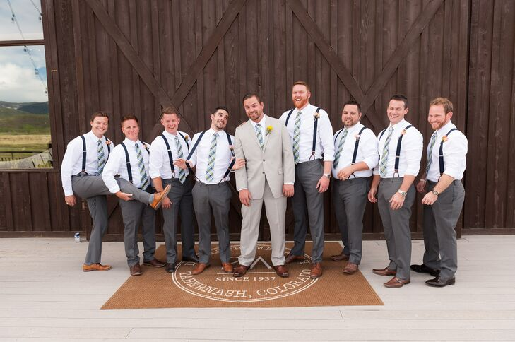 The groomsmen wore charcoal gray pants with navy suspenders and a navy and green ties.