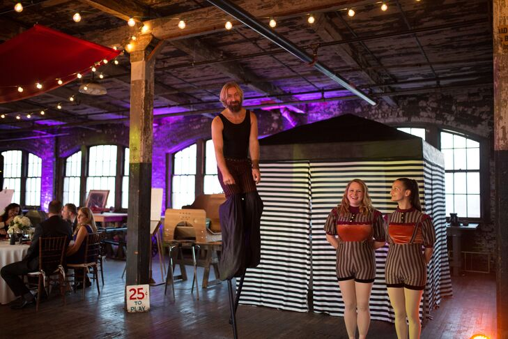 Members from the Detroit Circus greeted guests during the cocktail on stilts. Variety performers also mingled with the crowd -- taking photos and passing out wooden admission tickets that doubled as escort cards.