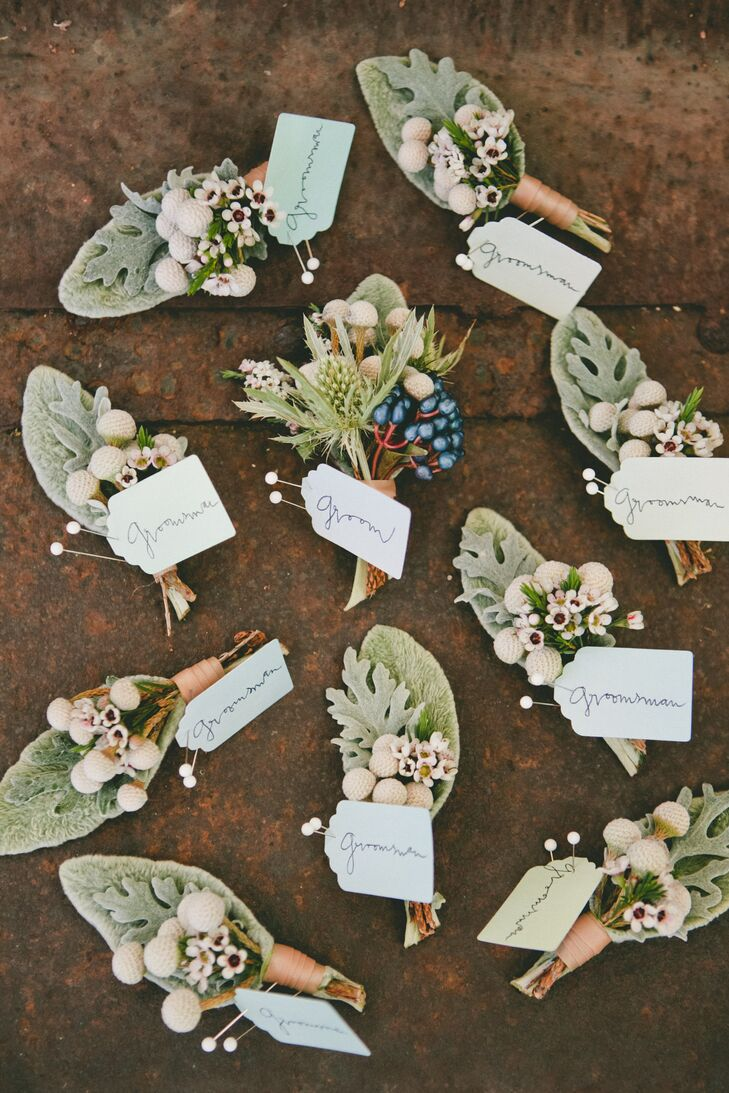 The boutonnieres worn by Kyle and his groomsmen all incorporated silver brunia and dusty miller into the natural-looking mix. Kyle's arrangement stood out with berries incorporated into the arrangement, adding a pop of color to his boutonniere.