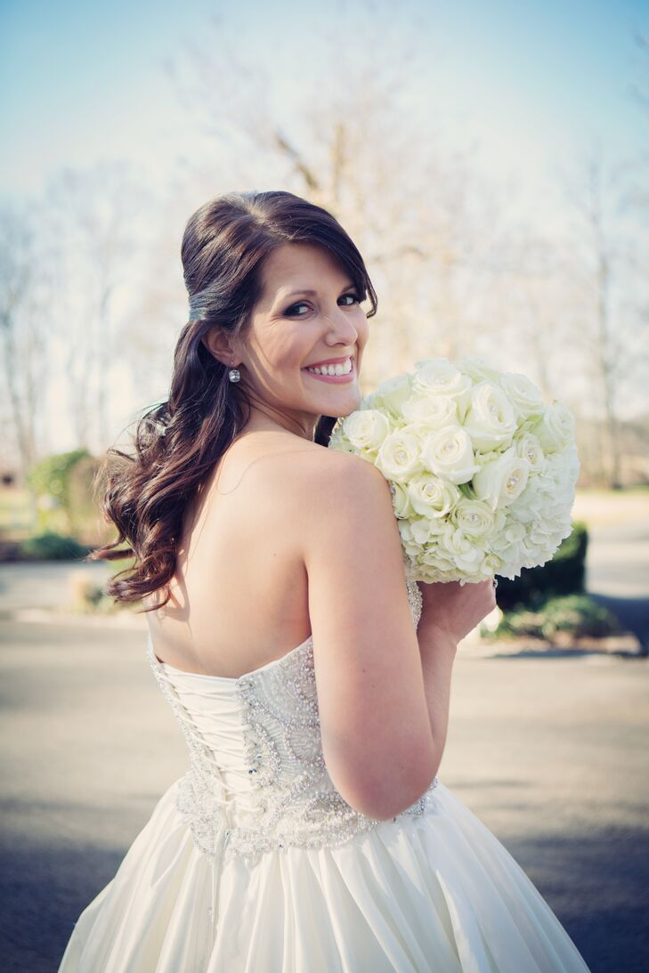Courtney and Ben had a Christmas wedding, but kept it modern with a color palette of classic white and silver with simple holiday decor. Courtney held an all-white round bouquet incorporating hydrangeas and roses.