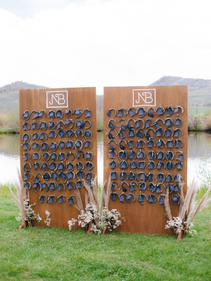 Escort Card Display with Wood Boards and Horseshoes