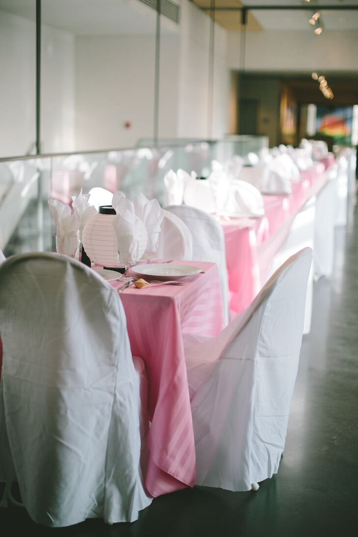 Genevieve and Justin loved the naturally sophisticated Lawrence Art Center and decided to keep their decor minimal so guests could enjoy the stunning artwork. They topped their reception tables with subtly striped pink linens and white paper lanterns to complement the space.