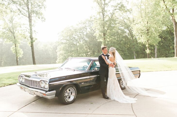 Newlyweds with Black Vintage Car