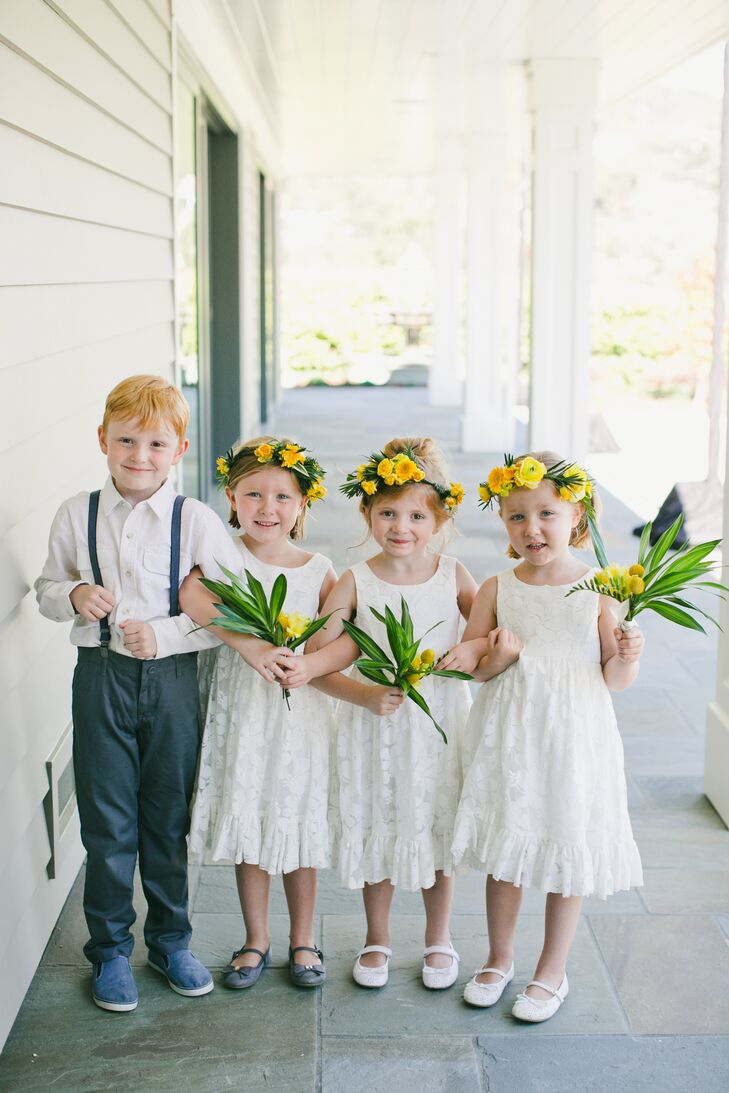 "Flower girls wore simple white dresses and yellow flower crowns. ""The flower girls requested dresses that they could twirl in, which we gladly obliged,"" Carolyn says."