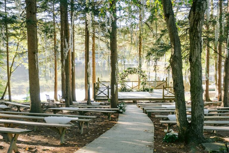 Curved aisle heading to lakeside ceremony space