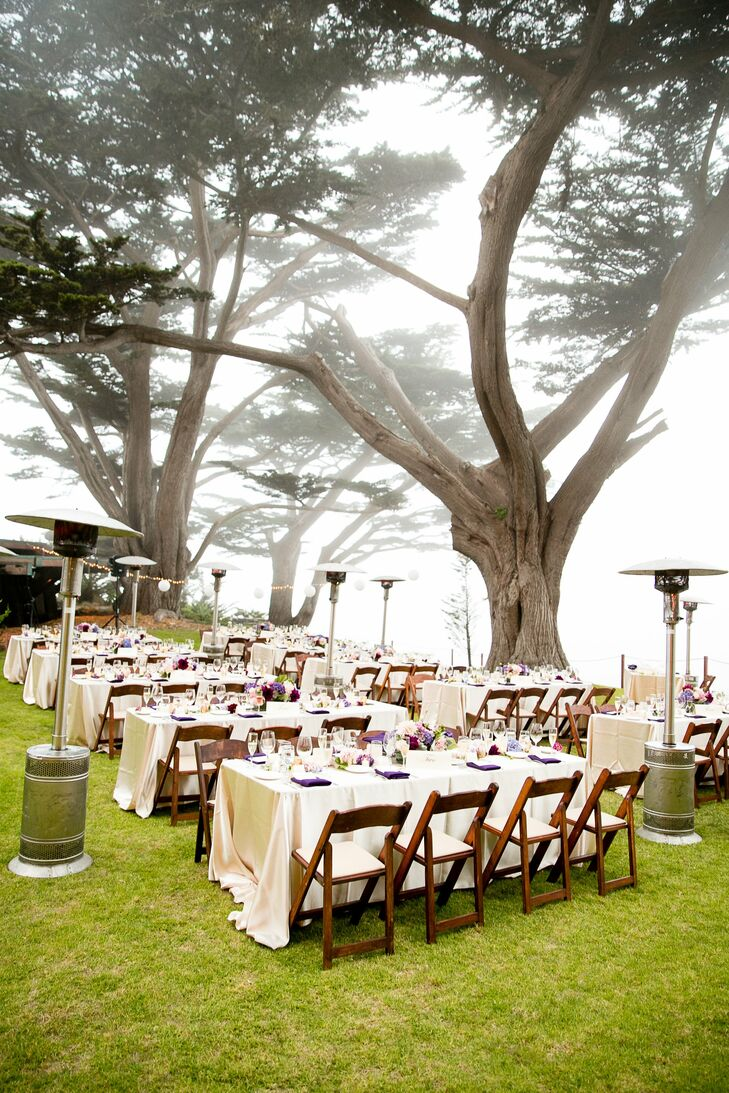 With large trees overhead, guests enjoyed their reception meal on long tables set with ivory linens.