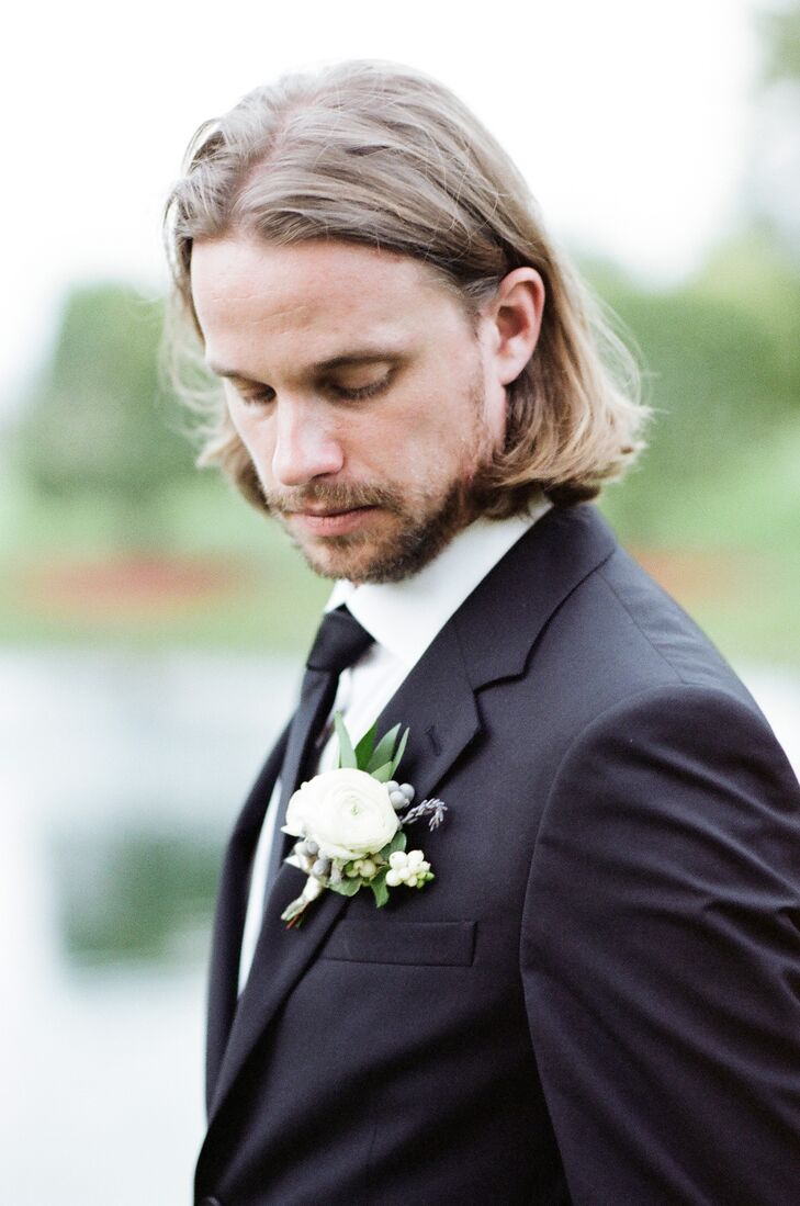 Classic Black Prada Suit with White Boutonniere