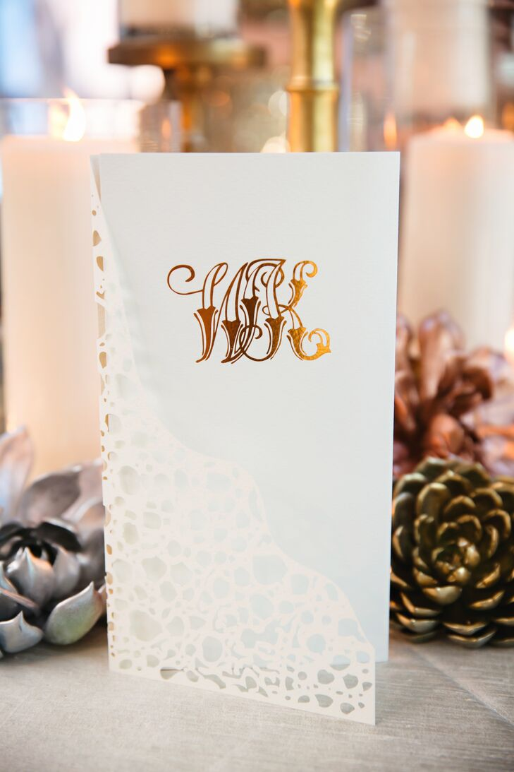 Kelly and Walt's ecru invitations provided a luxe twist on classic. They were laser-cut ecru paper with a metallic gold letterpress monogram.