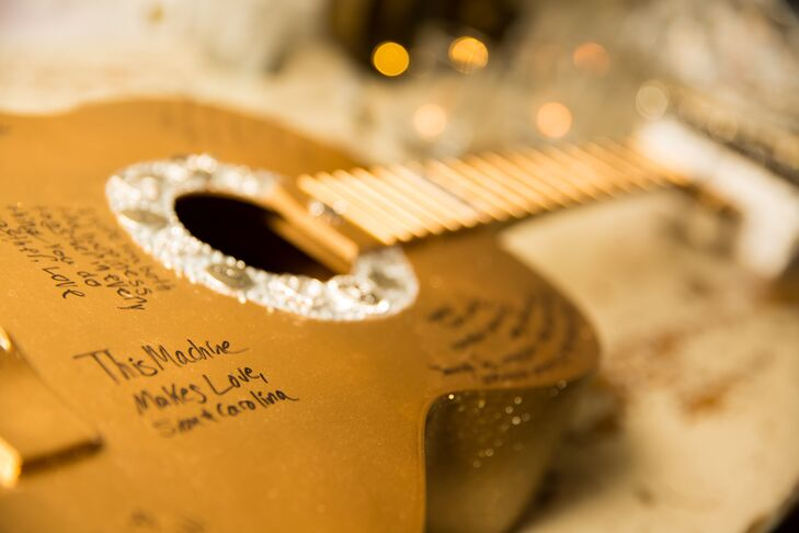 Instead of having their family and friends sign a traditional guest book, Galina and Andrew had them write their well wishes on an acoustic guitar.