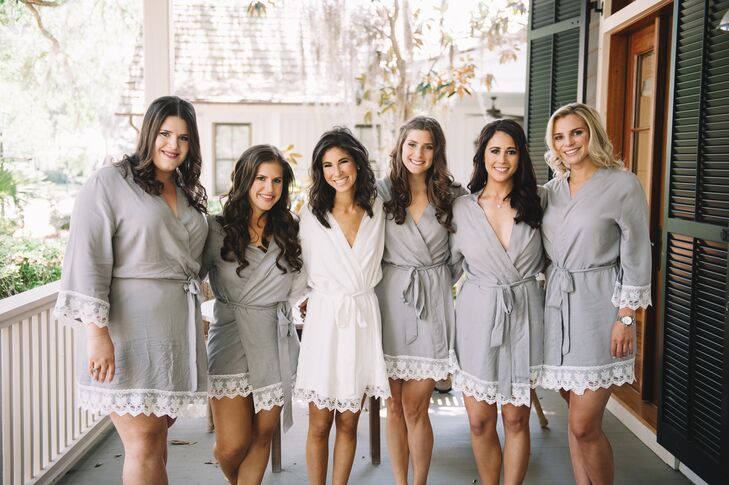 Molly's bridesmaid sported gray dressing gowns as they prepped for the day—matching the subtle hues of their bridesmaid gowns.