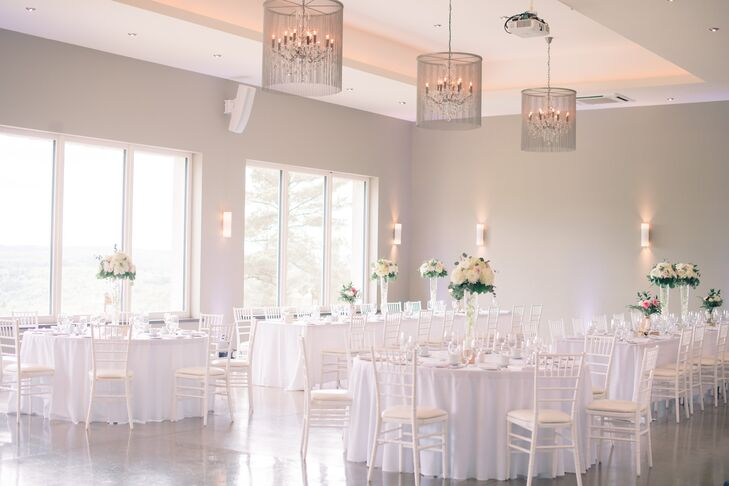"""While nature was the focus of Nancy and Indesh's outdoor ceremony, the reception took on a more contemporary tone with a simple white palette and a sleek modern aesthetic. """"I kept the linens white, since I liked the crisp, clean look, plus I wanted the gorgeous backdrop to stand out,"""" Nancy says."""