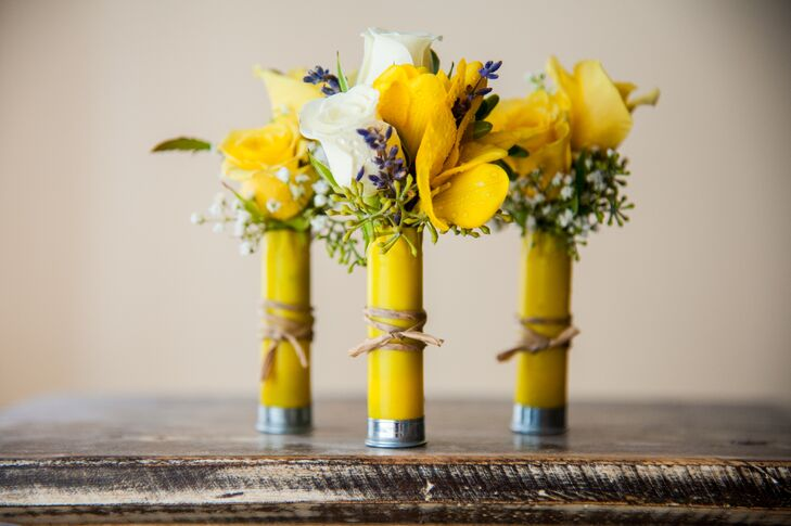 Jeremiah and his groomsmen had white and yellow boutonnieres arranged inside silver tubes, wrapped in yellow paper and tied with twine. The boutonnieres contained a mixture of roses, baby's breath, lavender and eucalyptus that went with the palette.