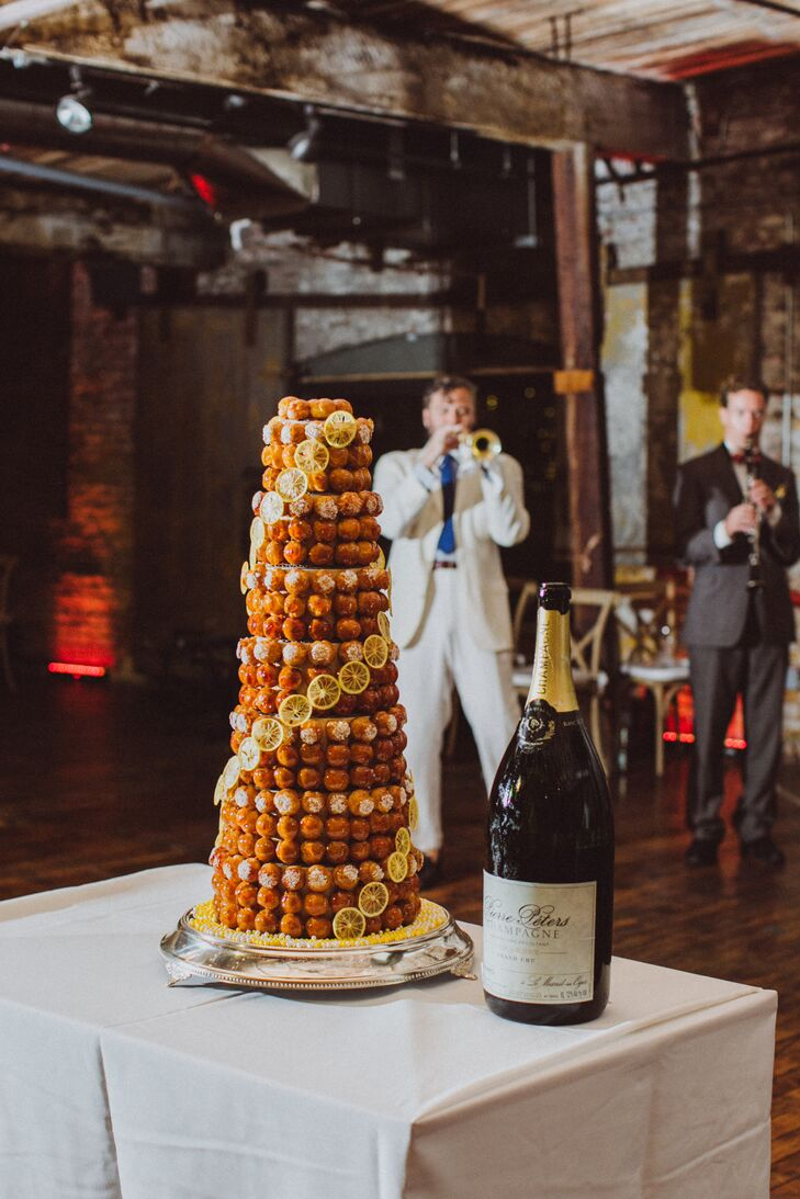 """I wanted to incorporate a traditional French element into our wedding and found the perfect place: cake time,"" Candice says. For a twist, the couple opted for a traditional French croquembouche in lieu of a classic fondant or buttercream confection. Playing off the affair's subtle lemon theme, Candice and Edouard had the croquembouche's choux filled with lemon curd and decorated with slices of candied lemon and pearl sugar."