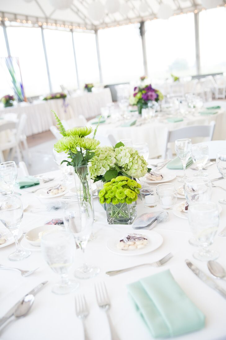 Centerpieces at the reception consisted of small bouquets of chrysanthemums and viburnum. The tables alternated with purple and green arrangements.
