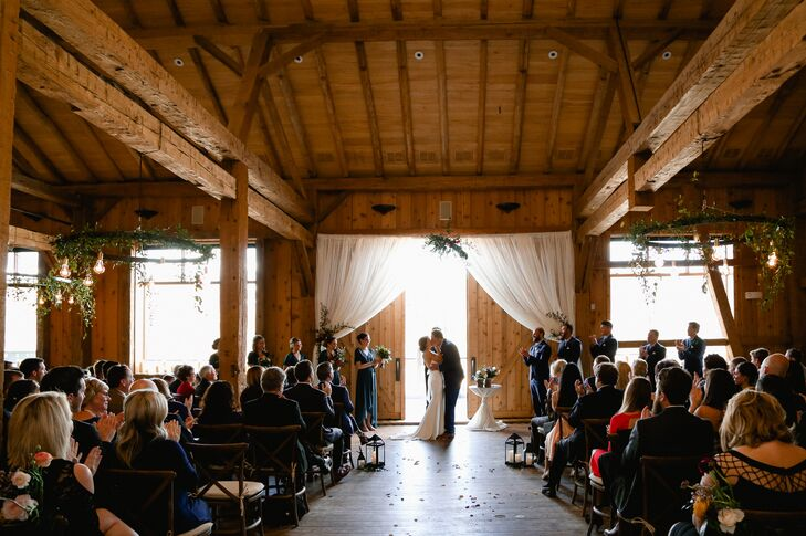 A large window showcased views of the Rocky Mountains from the indoor ceremony site at Devil's Thumb Ranch Resort & Spa in Tabernash, Colorado.