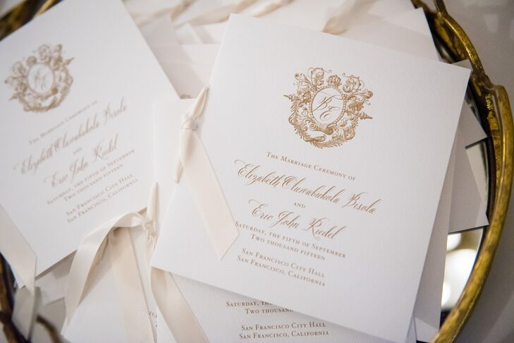 Beth and Eric opted for classic white and gold invitations, which included a custom gold crest inspired by the grand staircase of San Francisco City Hall.
