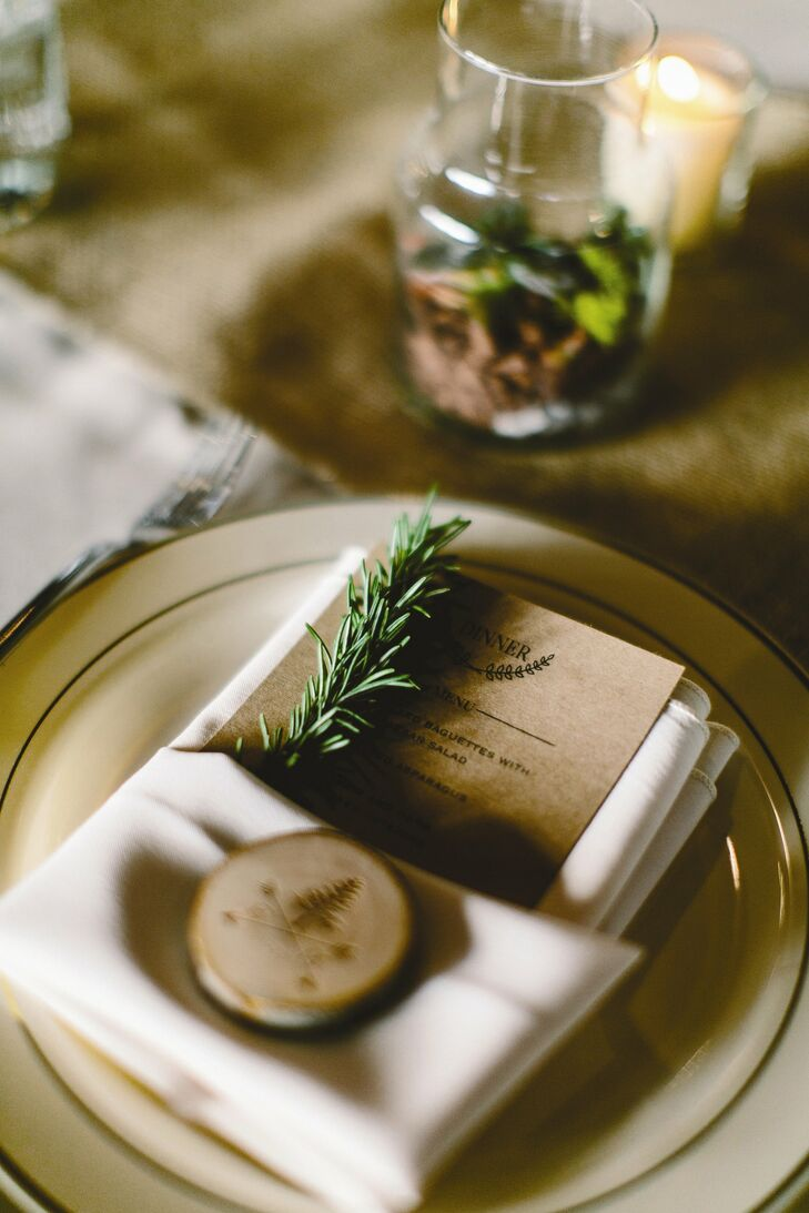 The couple hand designed their brown menu cards. Each was decorated with a sprig of rosemary.