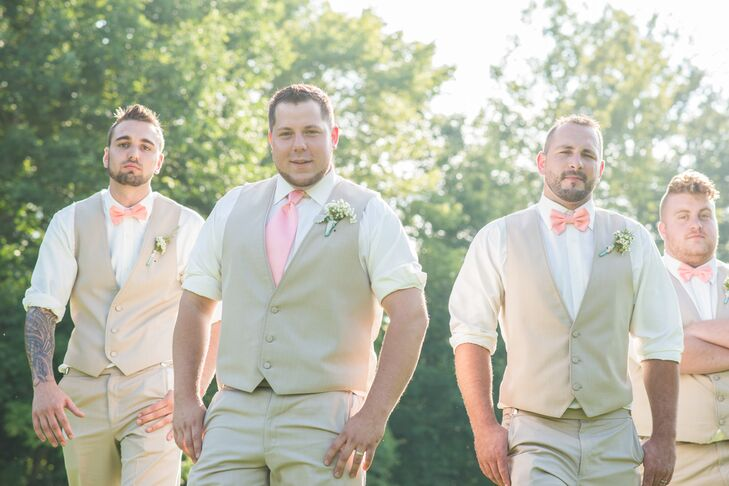 Keeping with the laid-back style of the wedding, Ben and his groomsmen wore matching tan vests and pants, with white collared shirts and rolled-up sleeves. To stand apart from his groomsmen, who wore coral bow ties, Ben wore a coral tie.