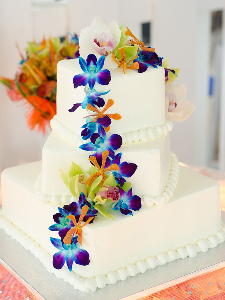 Tropical wedding cake with bright blue orchids