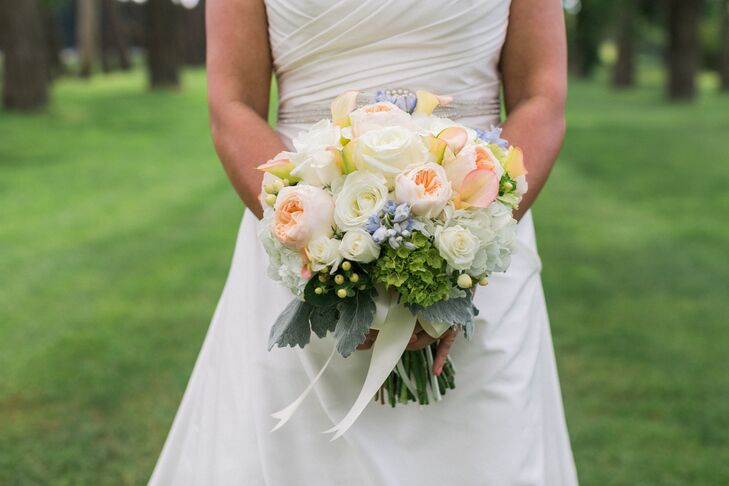 Diana Gould perfectly captured Noel and Tim's garden-inspired theme in all the floral details, from the bouquets to the boutonnieres and striking centerpieces. For her bouquet, Noel created a romantic bunch of full pastel blooms, including garden roses, ranunculus, hydrangeas, seeded eucalyptus and more.