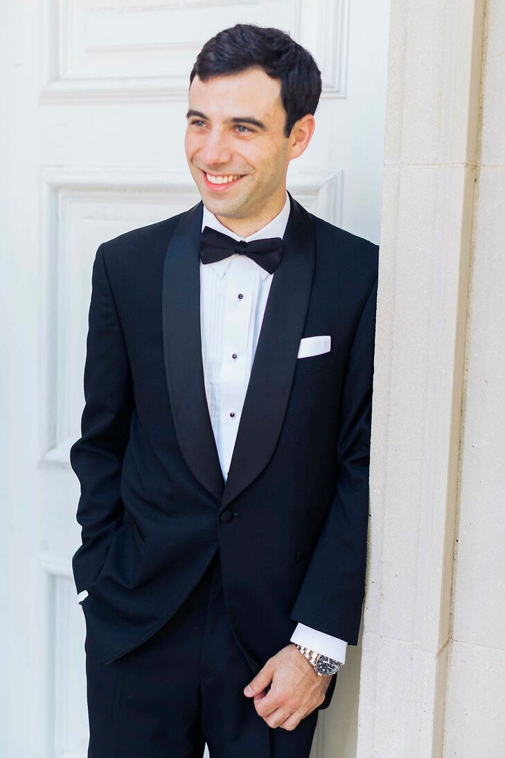 Nick's tuxedo was similar to his groomsmen's but featured a shawl collar. His tailored look was finished off with a crisp white pocket square.