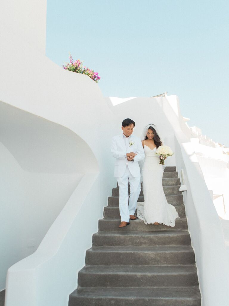 Bride walking down the aisle with father in Greece