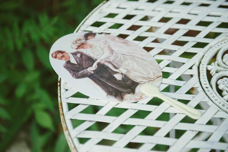 Garret's mother ordered these antique fans, with an image of a bride and groom on the front and a quote on the back, specifically for the wedding. Katie and Garret also provided an assortment of balsa wood fans for their guests.