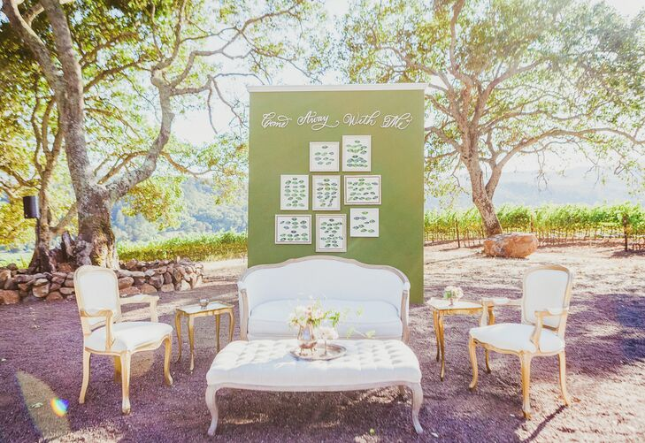 """After the ceremony, guests were shuttled from the ceremony site to the reception site at Boot Hill, where they could lounge on vintage sofas and sip on Kunde wines and local beers. """"Boot Hill is shaded by California oaks and overlooks sweeping vistas of the vineyards of the Valley of the Moon,"""" Emily says. """"The Valley of the Moon is one of the most beautiful locations in California wine country."""""""