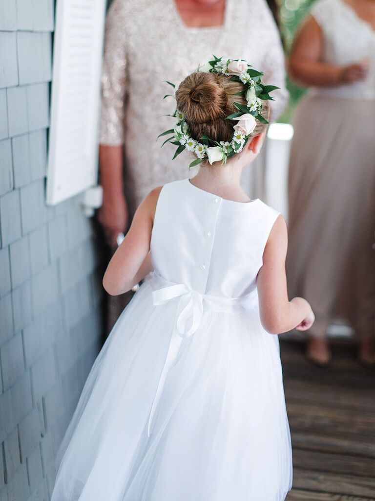 4b8d85114 Simple bun hairstyle with wreath for flower girls