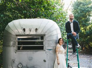 Liz Lankau and Andrew Breidenbach put a refined, romantic edge on their late-summer wedding with a dramatic emerald, raspberry and gold color palette