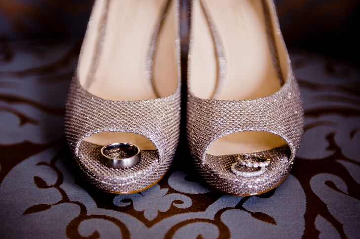 For an added pop of glitz, the bride paired her Amy Kuschel ball gown with silver, peep-toe heels.