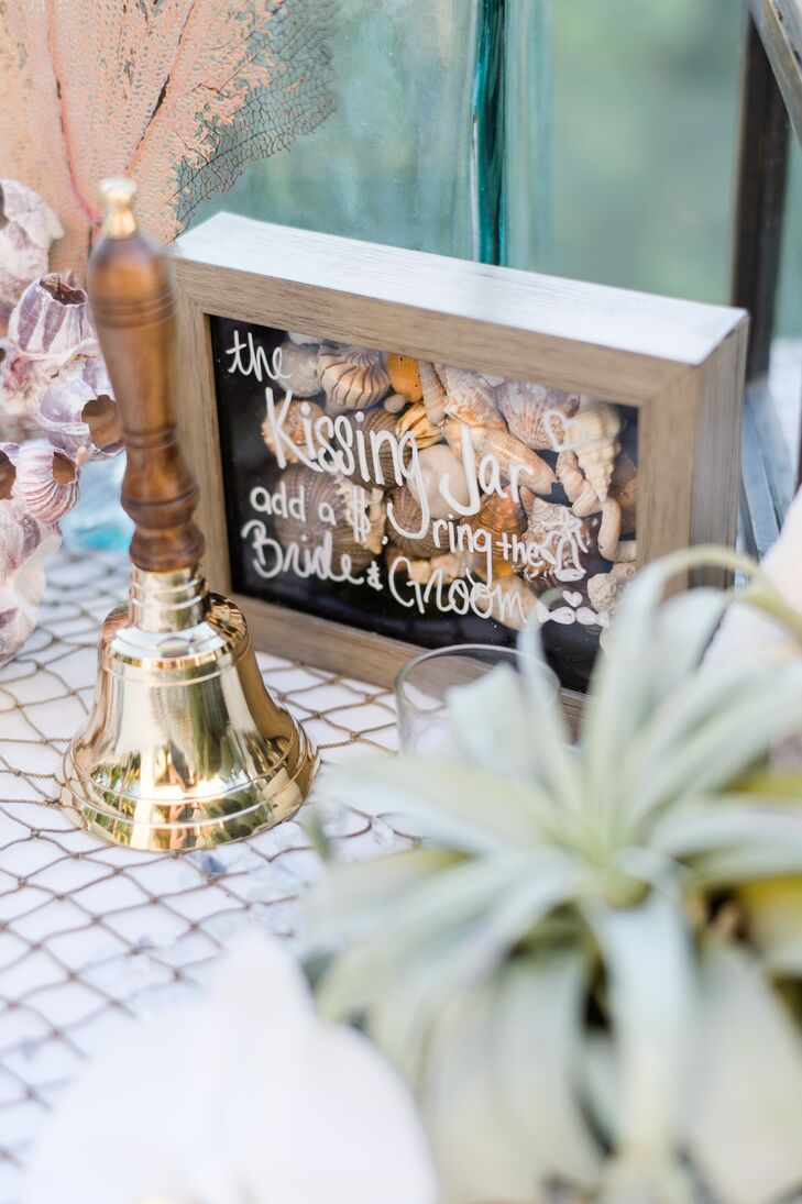Nicole and Bren placed a kissing jar on the guest book table. After slipping a dollar into the jar, guests rang the bell, signaling the newlyweds to steal a kiss.