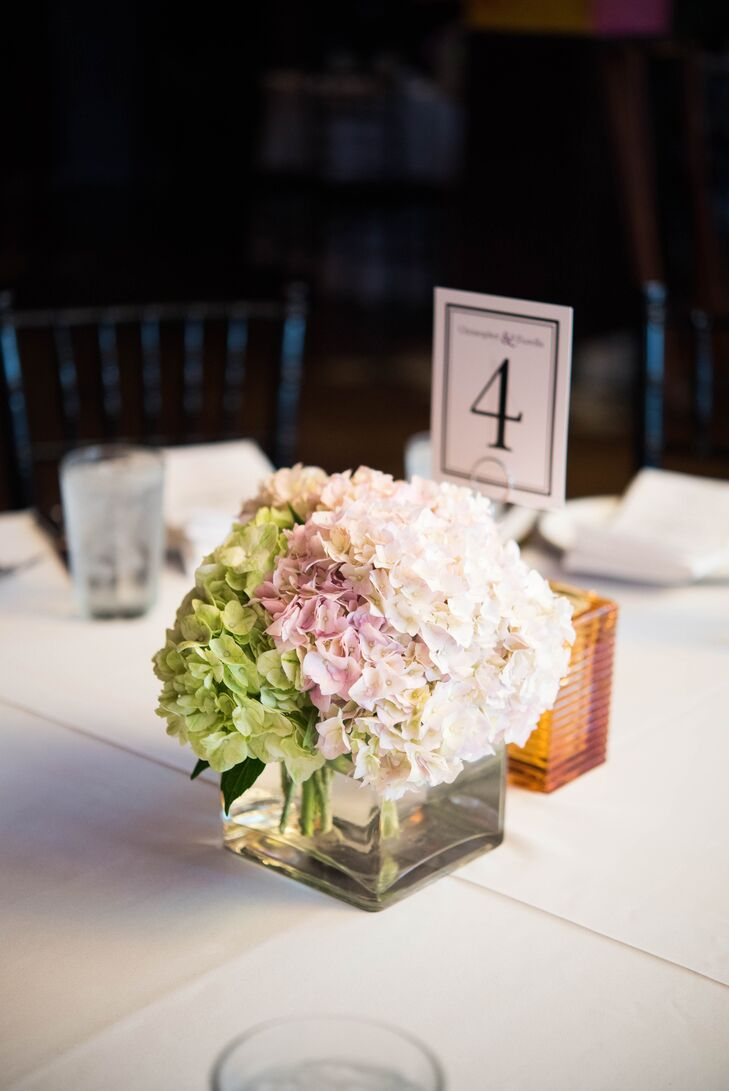 Green and white arrangements of hydrangeas were used to add a subtle pop of color to each tablescape.