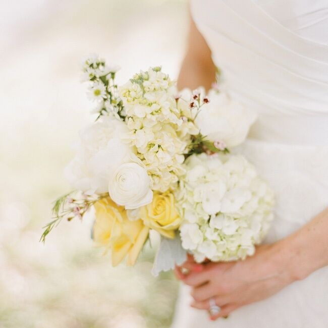 Roses, hydrangeas, stock, ranunculus and peonies in yellow hues made for a garden-fresh bouquet.