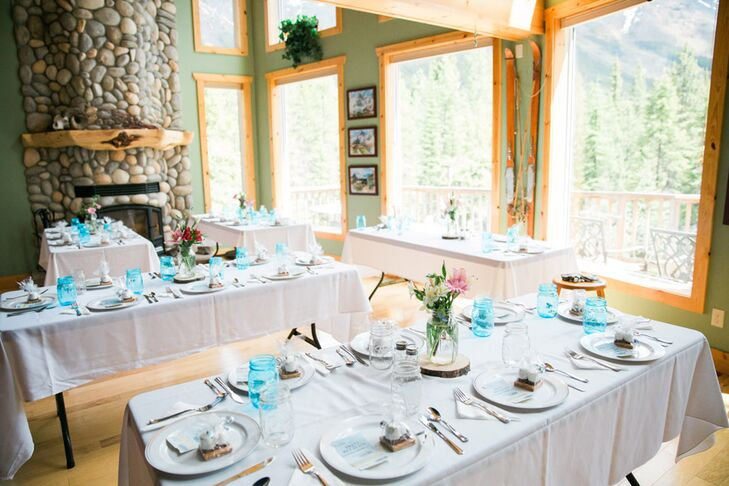 The reception took place nearby at Christine's family cabin. Long tables were arranged simply with white linens and mason jars for the event.