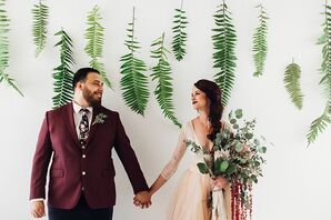 Groom in Burgundy Suit and Bride with Large Eucalyptus Bouquet