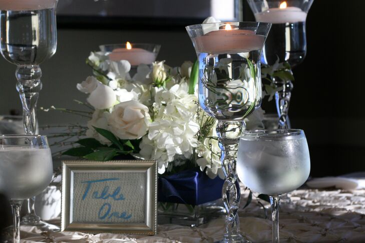 Centerpieces At The Reception Were Made Up Of White Roses And Hydrangeas With Floating Candles In